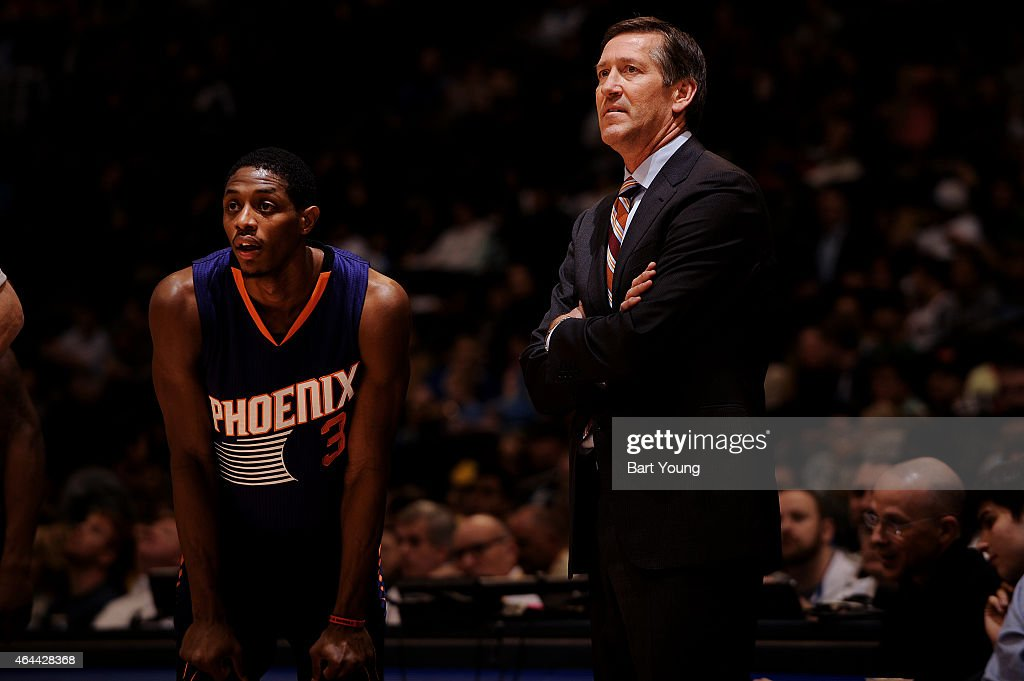 Brandon Knight of the Phoenix Suns stands with Head Coach Jeff Hornacek of the Phoenix Suns during the game against the Denver Nuggets on February 25...