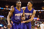 Brandon Knight reacts after diving to the floor as he walks off the court with Gerald Green of the Phoenix Suns during the second half at Quicken...
