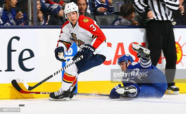 Brandon Kozun of the Toronto Maple Leafs gets knocked down by Steven Kampfer of the Florida Panthers during game action on February 17 2015 at Air...