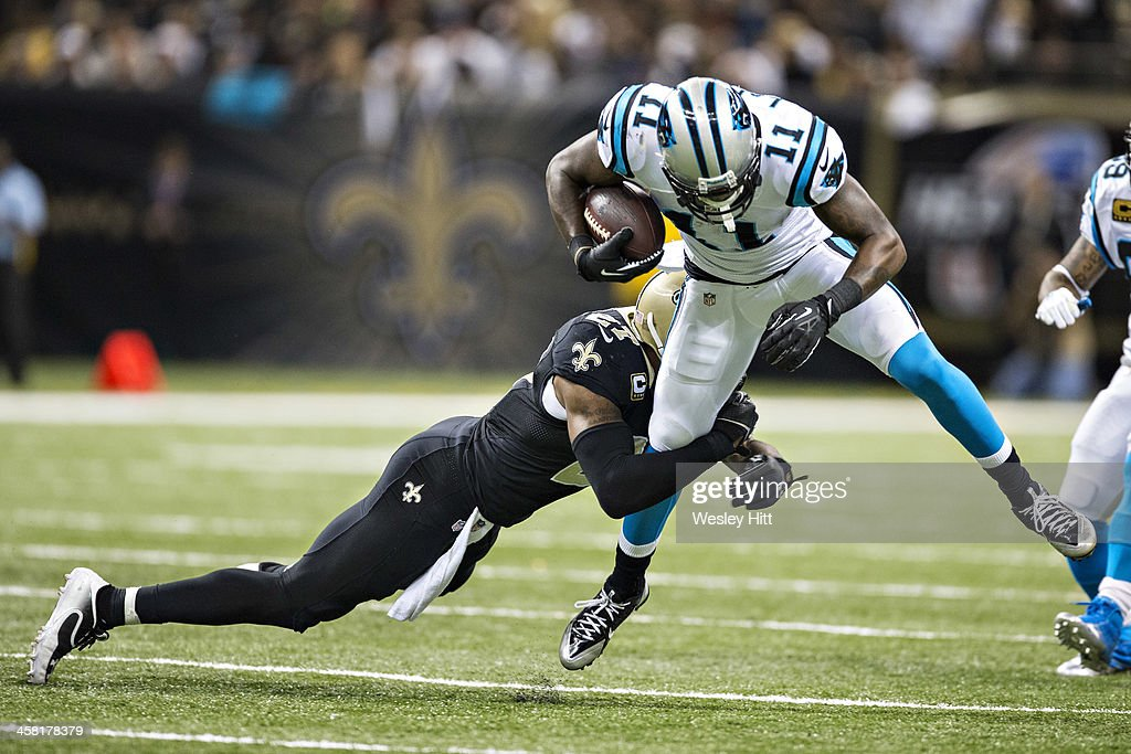 Brandon LaFell of the Carolina Panthers is tackled by Malcolm Jenkins of the New Orleans Saints at MercedesBenz Superdome on December 8 2013 in New...