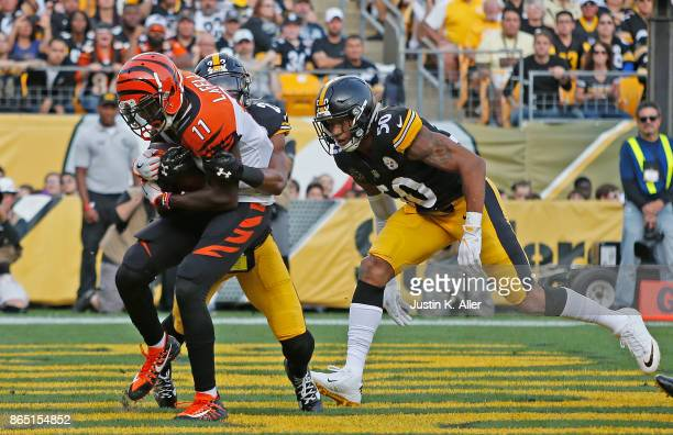 Brandon LaFell of the Cincinnati Bengals catches a pass from Andy Dalton for a 6 yard touchdown reception in the first quarter during the game...