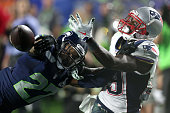 Brandon LaFell of the New England Patriots fails to complete the catch against Tharold Simon of the Seattle Seahawks during Super Bowl XLIX at...