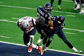 Brandon LaFell of the New England Patriots scores a touchdown over Earl Thomas and Tharold Simon of the Seattle Seahawks in the second quarter during...