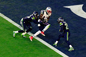 Brandon LaFell of the New England Patriots scores an 11 yard touchdown against Tharold Simon and Earl Thomas of the Seattle Seahawks in the second...