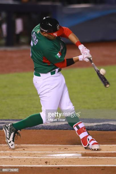 Brandon Laird of Mexico hits the ball in the top of the first inning during the World Baseball Classic Pool D Game 1 between Italy and Mexico at...