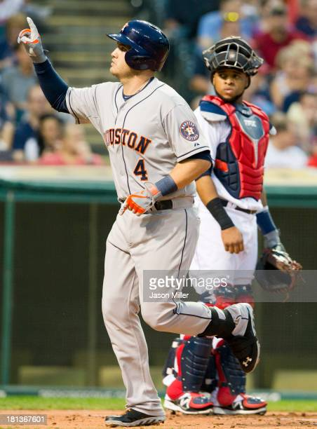 Brandon Laird of the Houston Astros celebrates his solo home run during the second inning as catcher Carlos Santana of the Cleveland Indians looks on...