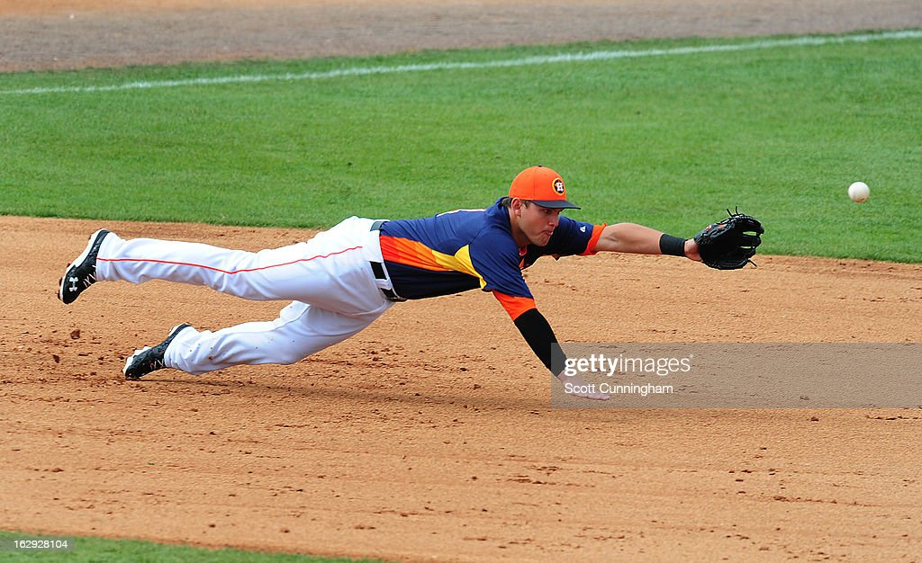 Brandon Laird #4 of the Houston Astros dives for a ground ball against the St. Louis Cardinals during a spring training game at Osceola County Stadium on March 1, 2013 in Kissimmee, Florida.