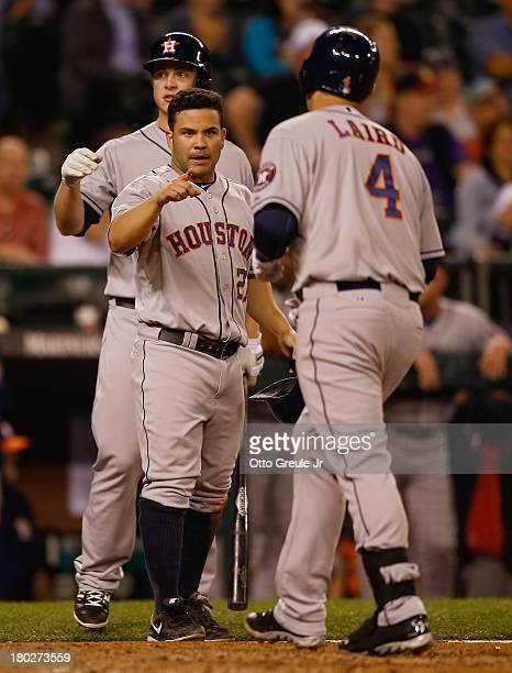 Brandon Laird of the Houston Astros is congratulated by Jose Altuve after hitting a tworun homer against the Seattle Mariners in the seventh inning...