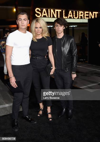 Brandon Lee actress Pamela Anderson and model Dylan Lee in Saint Laurent by Hedi Slimane attend Saint Laurent at the Palladium on February 10 2016 in...