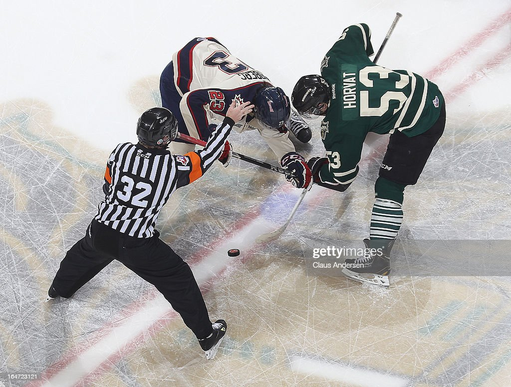 Brandon Lindberg #23 of the Saginaw Spirit takes a faceoff against Bo Horvat #53 of the London Knights in a first round playoff game on March 24, 2013 at the Budweiser Gardens in London, Ontario, Canada. The Knights defeated the Spirit 3-2 in double overtime to take a 2-0 series lead.