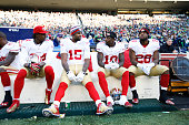 Brandon Lloyd Michael Crabtree Bruce Ellington and Carlos Hyde of the San Francisco 49ers sit on the bench during the game against the Seattle...