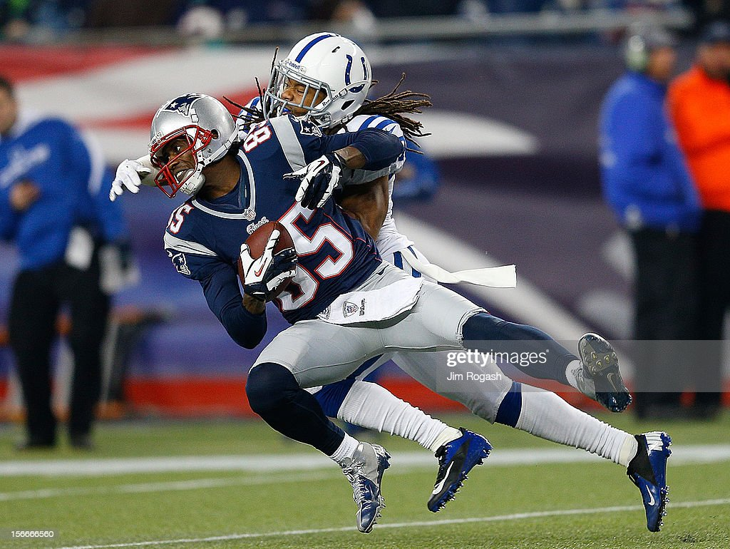 <a gi-track='captionPersonalityLinkClicked' href=/galleries/search?phrase=Brandon+Lloyd&family=editorial&specificpeople=206502 ng-click='$event.stopPropagation()'>Brandon Lloyd</a> #85 of the New England Patriots catches a pass as Josh Gordy #27 of the Indianapolis Colts defends in the second half at Gillette Stadium on November 18, 2012 in Foxboro, Massachusetts.