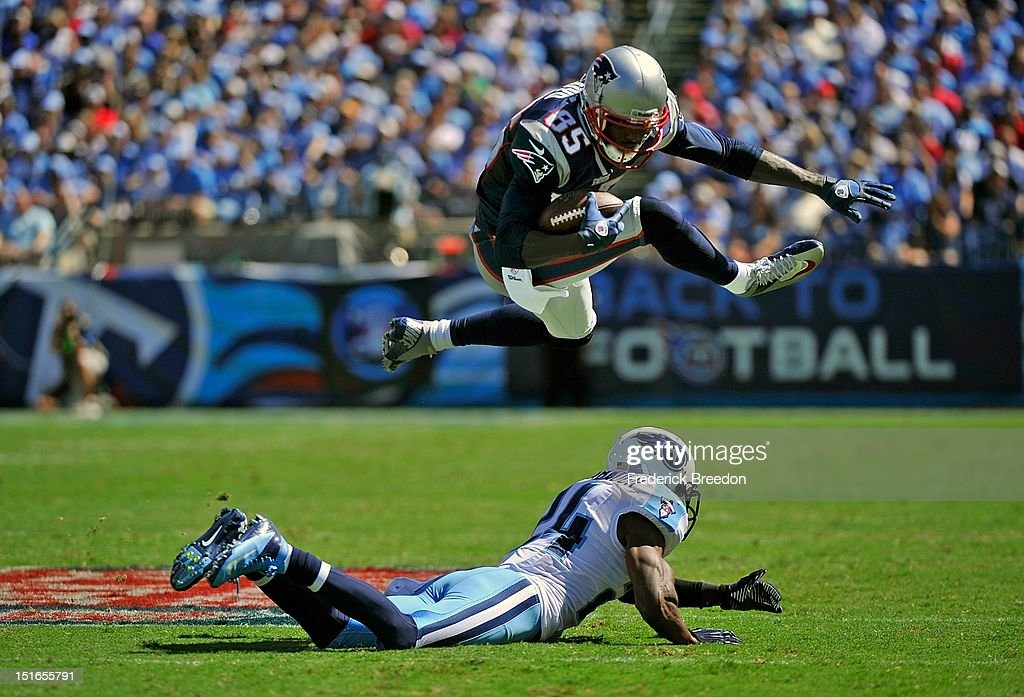 <a gi-track='captionPersonalityLinkClicked' href=/galleries/search?phrase=Brandon+Lloyd&family=editorial&specificpeople=206502 ng-click='$event.stopPropagation()'>Brandon Lloyd</a> #85 of the New England Patriots jumps over Coty Sensabaugh #24 of the Tennessee Titans during their season opener at LP Field on September 9, 2012 in Nashville, Tennessee.