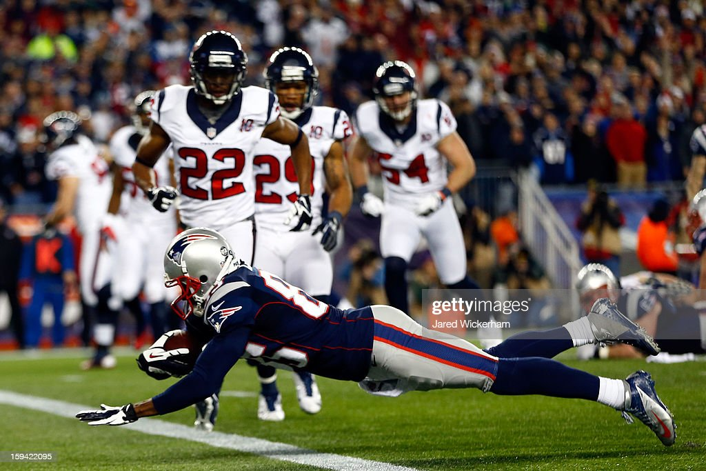 Brandon Lloyd #85 of the New England Patriots lunges for a touchdown in the third quarter against the Houston Texans during the 2013 AFC Divisional Playoffs game at Gillette Stadium on January 13, 2013 in Foxboro, Massachusetts.
