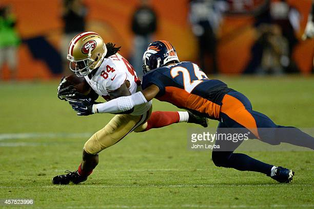 Brandon Lloyd of the San Francisco 49ers is tackled by Rahim Moore of the Denver Broncos in the second quarter The Denver Broncos played the San...
