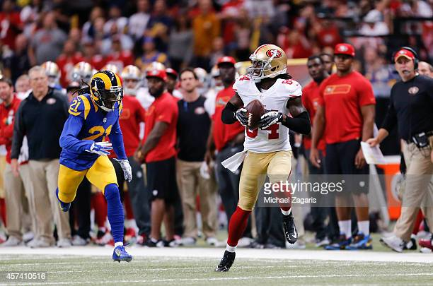 Brandon Lloyd of the San Francisco 49ers makes a reception and takes it downfield on a 80yard touchdown pass during the game against the St Louis...