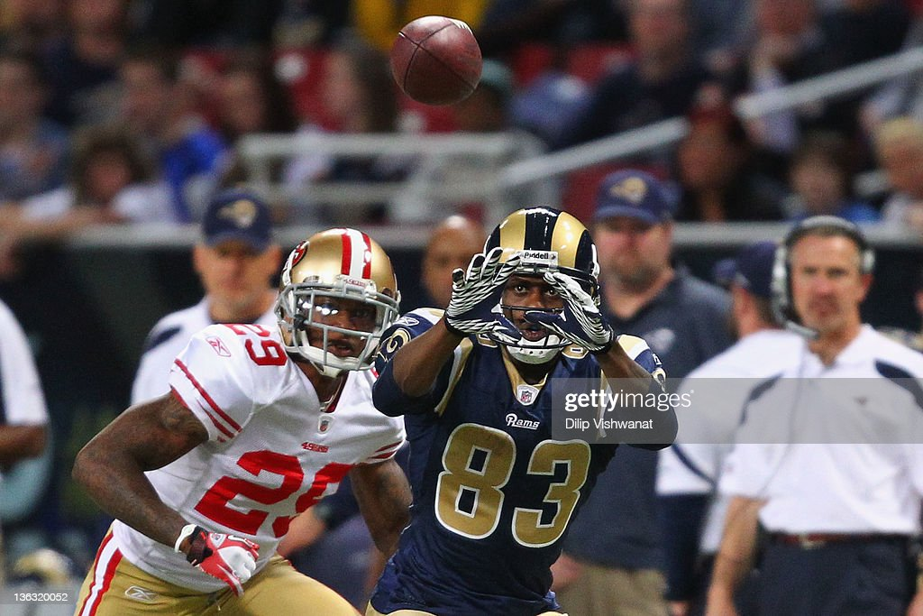 <a gi-track='captionPersonalityLinkClicked' href=/galleries/search?phrase=Brandon+Lloyd&family=editorial&specificpeople=206502 ng-click='$event.stopPropagation()'>Brandon Lloyd</a> #83 of the St. Louis Rams looks to make a catch against Chris Culliver #29 of the San Francisco 49ers at the Edward Jones Dome on January 1, 2012 in St. Louis, Missouri. The 49ers beat the Rams 34-27.