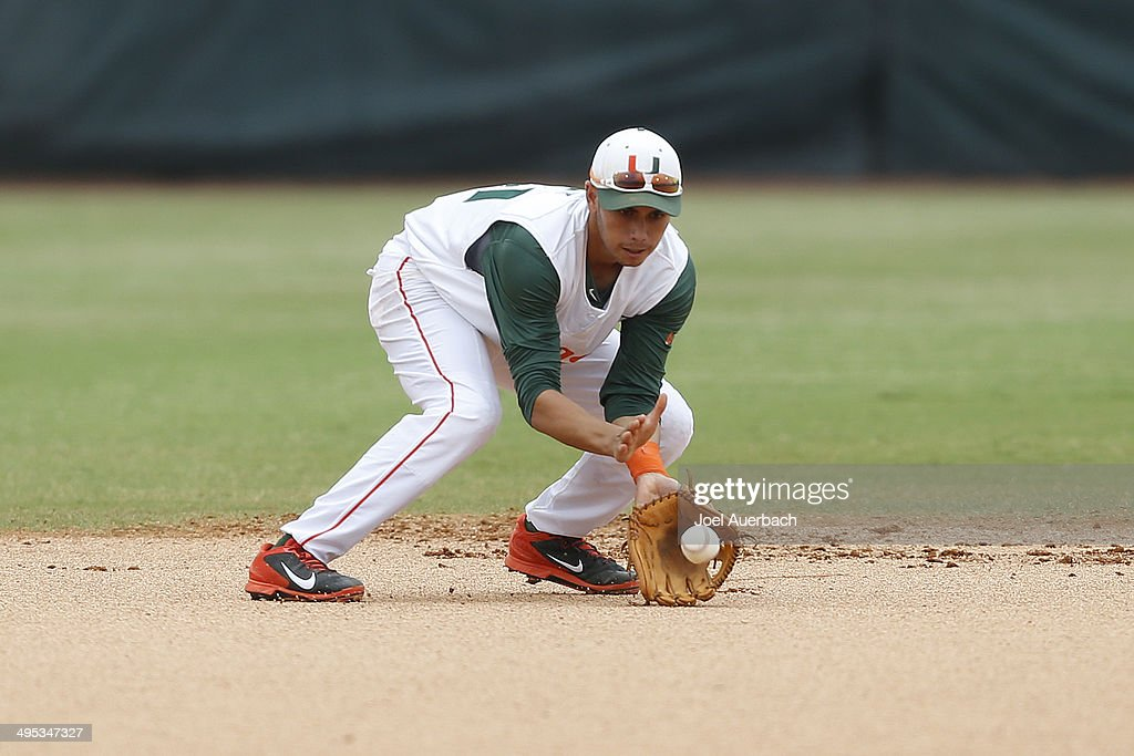 Brandon Lopez of the Miami Hurricanes fields ball from Bryant Burleson of the Texas Tech Red Raiders during the Coral Gables Regional at the NCAA...