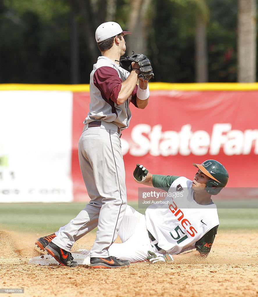 Brandon Lopez #51 of the Miami Hurricanes reaches second base on a bunt in the top of the eighth inning against the Virginia Tech Hokies on March 24, 2013 at Alex Rodriguez Park at Mark Light Field in Coral Gables, Florida. Virginia Tech defeated Miami 8-5 in 10 innings.