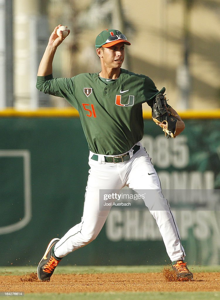Brandon Lopez #51 of the Miami Hurricanes throws out Nick Crucet #11 (not pictured) of the Columbia Lions in the first inning on March 19, 2013 at Alex Rodriguez Park at Mark Light Field in Coral Gables, Florida. Miami defeated Columbia 9-6.