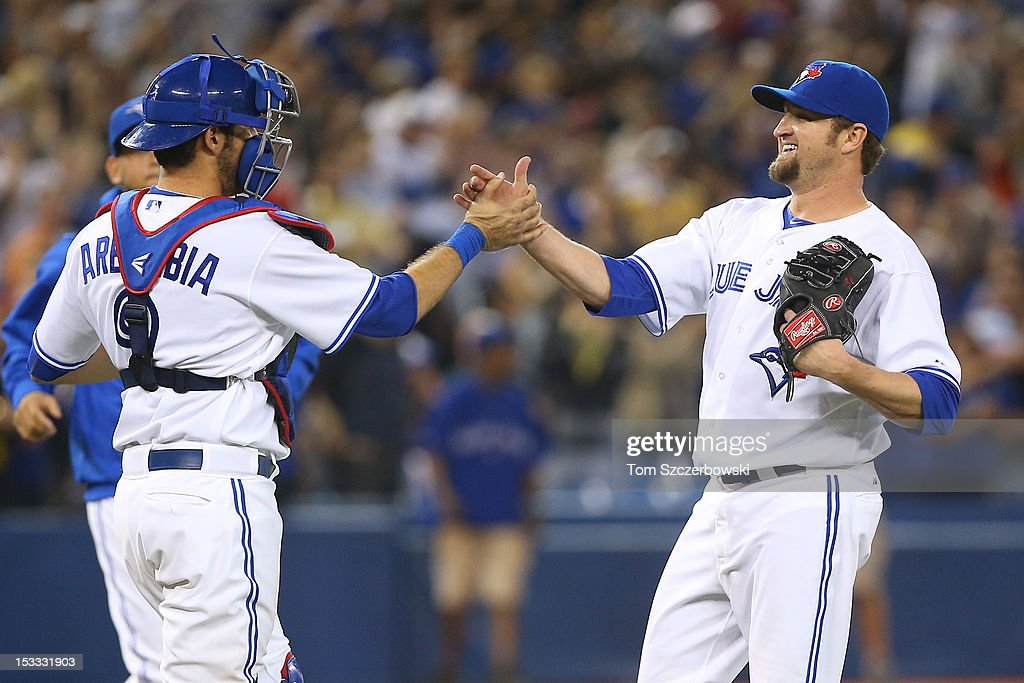 Brandon Lyon #31 of the Toronto Blue Jays celebrates with <a gi-track='captionPersonalityLinkClicked' href=/galleries/search?phrase=J.P.+Arencibia&family=editorial&specificpeople=4959430 ng-click='$event.stopPropagation()'>J.P. Arencibia</a> #9 after defeating the Minnesota Twins in MLB action on October 3, 2012 at Rogers Centre in Toronto, Ontario, Canada.