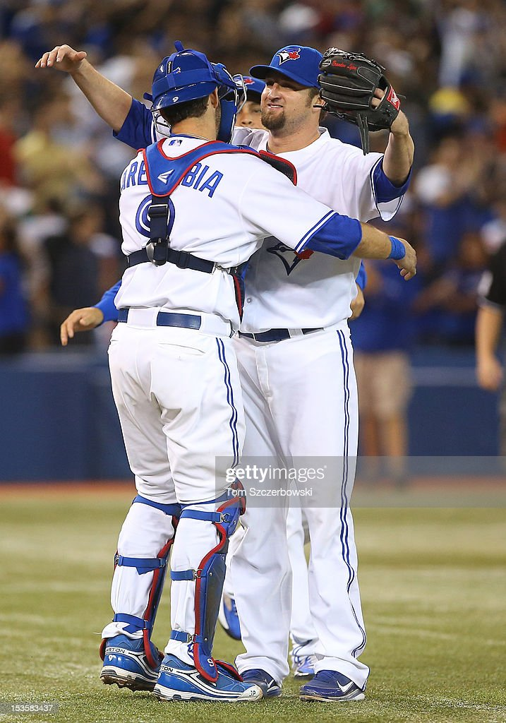 Brandon Lyon #31 of the Toronto Blue Jays celebrates with J.P. Arencibia #9 after defeating the Minnesota Twins in MLB action on October 3, 2012 at Rogers Centre in Toronto, Ontario, Canada.