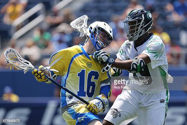 Brandon Mangan of Florida Launch is defended by Mark McNeill of the Chesapeake Bayhawks during the game at FAU Stadium on April 26 2015 in Boca Raton...