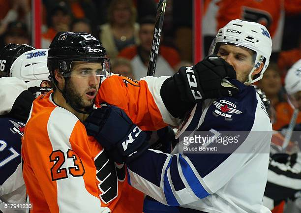 Brandon Manning of the Philadelphia Flyers and Ben Chiarot of the Winnipeg Jets battle at the Wells Fargo Center on March 28 2016 in Philadelphia...