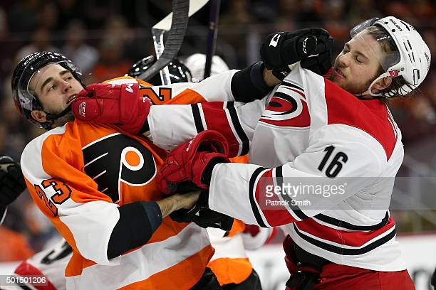 Brandon Manning of the Philadelphia Flyers and Elias Lindholm of the Carolina Hurricanes shove one another during the third period at Wells Fargo...
