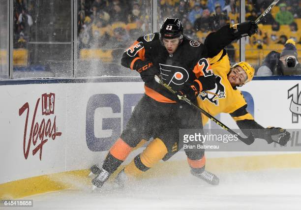 Brandon Manning of the Philadelphia Flyers and Scott Wilson of the Pittsburgh Penguins skate after the puck in the corner during the third period of...