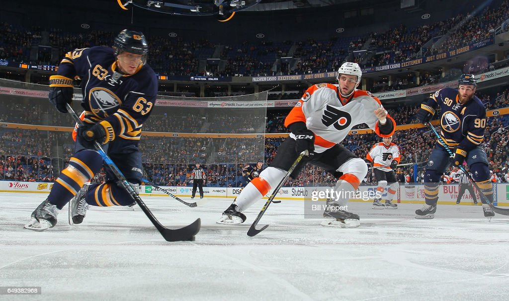 Brandon Manning #23 of the Philadelphia Flyers defends against Tyler Ennis #63 of the Buffalo Sabres during an NHL game at the KeyBank Center on March 7, 2017 in Buffalo, New York. The Flyers won, 6-3.