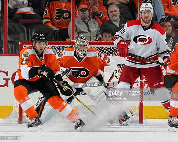 Brandon Manning of the Philadelphia Flyers defends goaltender Steve Mason against Bryan Bickell of the Carolina Hurricanes on October 22 2016 at the...