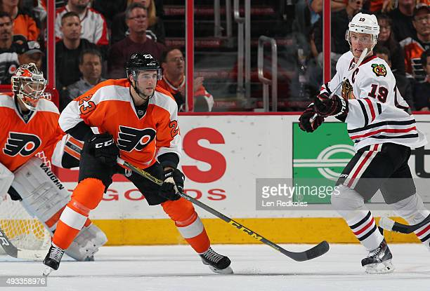 Brandon Manning of the Philadelphia Flyers in action against Jonathan Toews of the Chicago Blackhawks on October 14 2015 at the Wells Fargo Center in...
