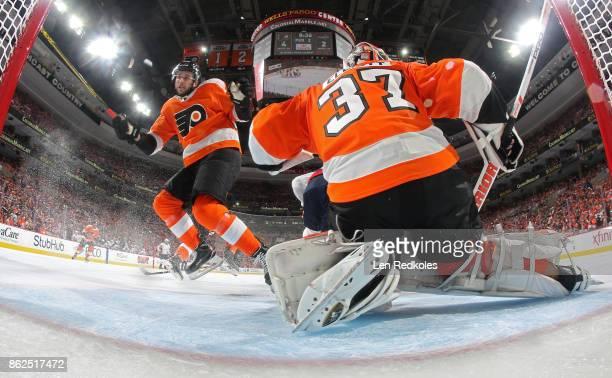 Brandon Manning of the Philadelphia Flyers scrambles to defend the crease of goaltender Brian Elliott against the Washington Capitals on October 14...