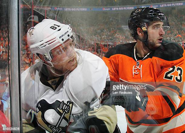Brandon Manning of the Philadelphia Flyers shoves Phil Kessel of the Pittsburgh Penguins into the boards in the corner on March 19 2016 at the Wells...