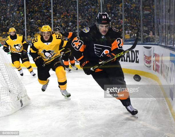 Brandon Manning of the Philadelphia Flyers skates after the puck against the Pittsburgh Penguins at Heinz Field on February 25 2017 in Pittsburgh...