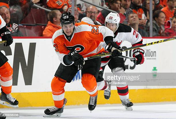 Brandon Manning of the Philadelphia Flyers skates against Lee Stempniak of the New Jersey Devils on October 29 2015 at the Wells Fargo Center in...