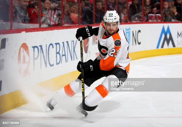 Brandon Manning of the Philadelphia Flyers skates for position behind the net during an NHL game against the Carolina Hurricanes on January 31 2017...