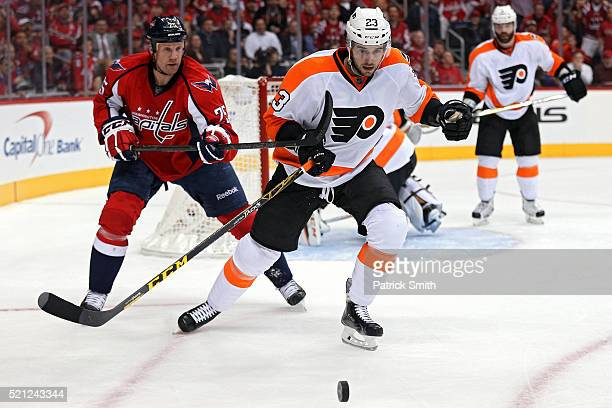 Brandon Manning of the Philadelphia Flyers skates past Jason Chimera of the Washington Capitals during the second period in Game One of the Eastern...