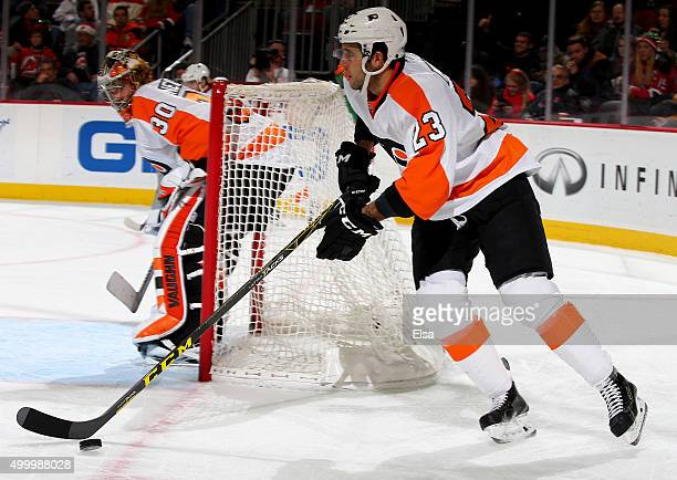 Brandon Manning of the Philadelphia Flyers takes the puck in the second period against the New Jersey Devils on December 4 2015 at Prudential Center...