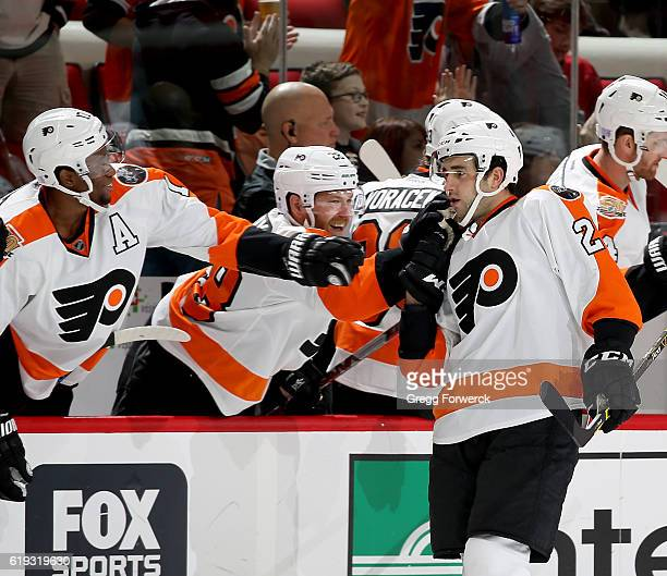 Brandon Manning of the Philadephia Flyers is congratulated by teammates on his goal during and NHL game against the Carolina Hurricanes on October 30...