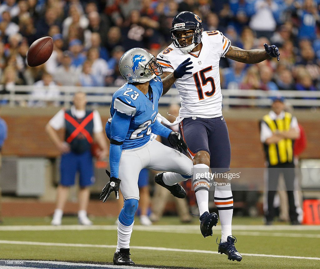Brandon Marshall #15 of the Chicago Bears can't come up with with a fourth quarter pass in the end zone in front of Chris Houston #23 of the Detroit Lions at Ford Field on December 30, 2012 in Detroit, Michigan. Chicago won the game 26-24.