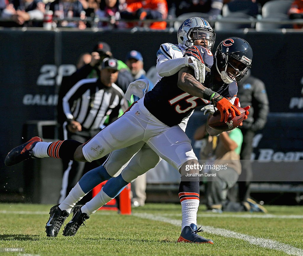 Brandon Marshall #15 of the Chicago Bears catches a touchdown pass under pressure from <a gi-track='captionPersonalityLinkClicked' href=/galleries/search?phrase=Darius+Slay&family=editorial&specificpeople=8346374 ng-click='$event.stopPropagation()'>Darius Slay</a> #30 of the Detroit Lions at Soldier Field on November 10, 2013 in Chicago, Illinois.