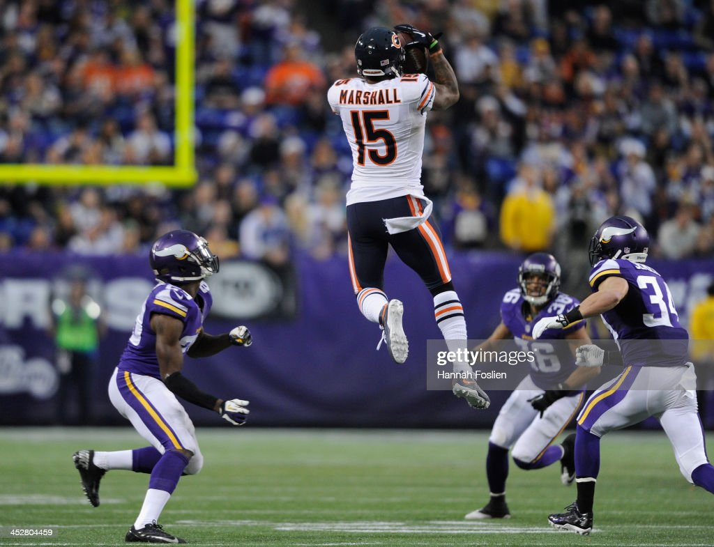 Brandon Marshall #15 of the Chicago Bears catches the ball as <a gi-track='captionPersonalityLinkClicked' href=/galleries/search?phrase=Xavier+Rhodes&family=editorial&specificpeople=7191729 ng-click='$event.stopPropagation()'>Xavier Rhodes</a> #29, <a gi-track='captionPersonalityLinkClicked' href=/galleries/search?phrase=Robert+Blanton&family=editorial&specificpeople=5525793 ng-click='$event.stopPropagation()'>Robert Blanton</a> #36 and <a gi-track='captionPersonalityLinkClicked' href=/galleries/search?phrase=Andrew+Sendejo&family=editorial&specificpeople=3494957 ng-click='$event.stopPropagation()'>Andrew Sendejo</a> #34 of the Minnesota Vikings looks on during the fourth quarter of the game on December 1, 2013 at Mall of America Field at the Hubert H. Humphrey Metrodome in Minneapolis, Minnesota. The Vikings defeated the Bear 23-20 in overtime.