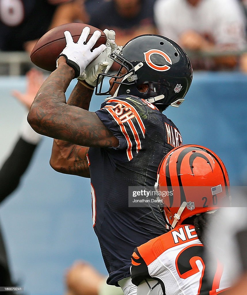 Brandon Marshall #15 of the Chicago Bears catches the game-winning touchdown pass over <a gi-track='captionPersonalityLinkClicked' href=/galleries/search?phrase=Reggie+Nelson&family=editorial&specificpeople=2141088 ng-click='$event.stopPropagation()'>Reggie Nelson</a> #20 of the Cincinnati Bengals at Soldier Field on September 8, 2013 in Chicago, Illinois. The Bears defeated the Bengals 24-21.