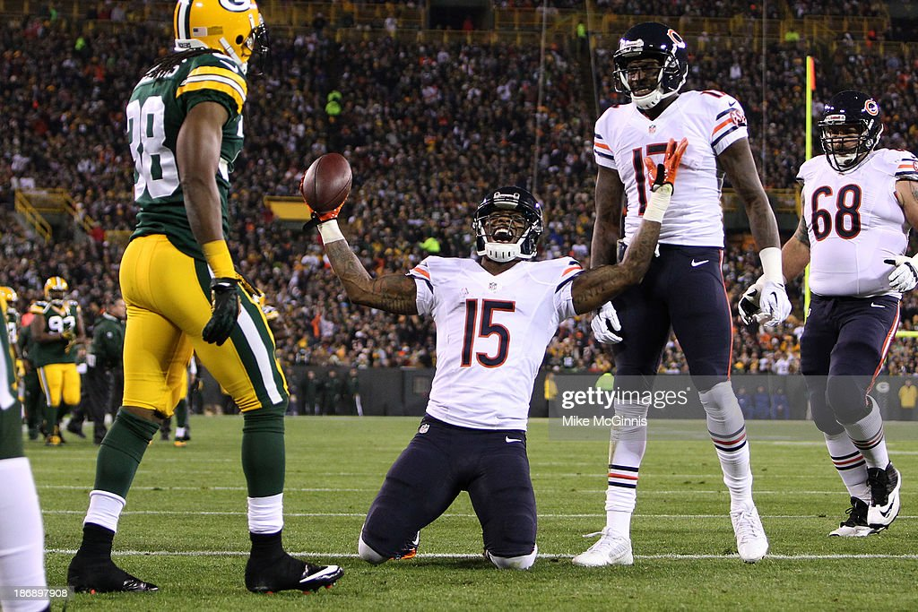 Brandon Marshall #15 of the Chicago Bears celebrates after scoring a touchdown during the first quarter against the Green Bay Packers at Lambeau Field on November 04, 2013 in Green Bay, Wisconsin.