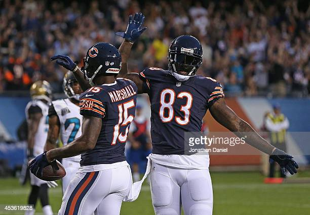 Brandon Marshall of the Chicago Bears celebrates his second quarter touchdown with Martellus Bennet during their preseason game against the...