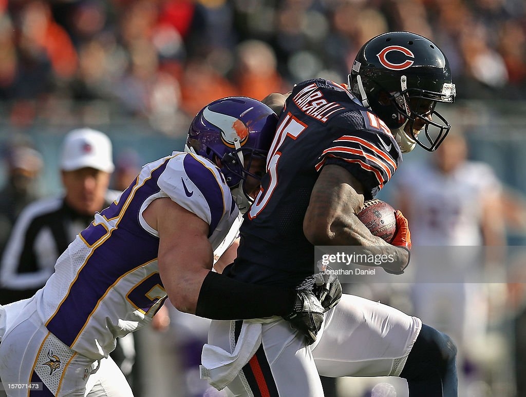 Brandon Marshall #15 of the Chicago Bears is hit by Harrison Smith #22 of the Minnesota Vikings at Soldier Field on November 25, 2012 in Chicago, Illinois. The Bears defeated the Vikings 28-10.