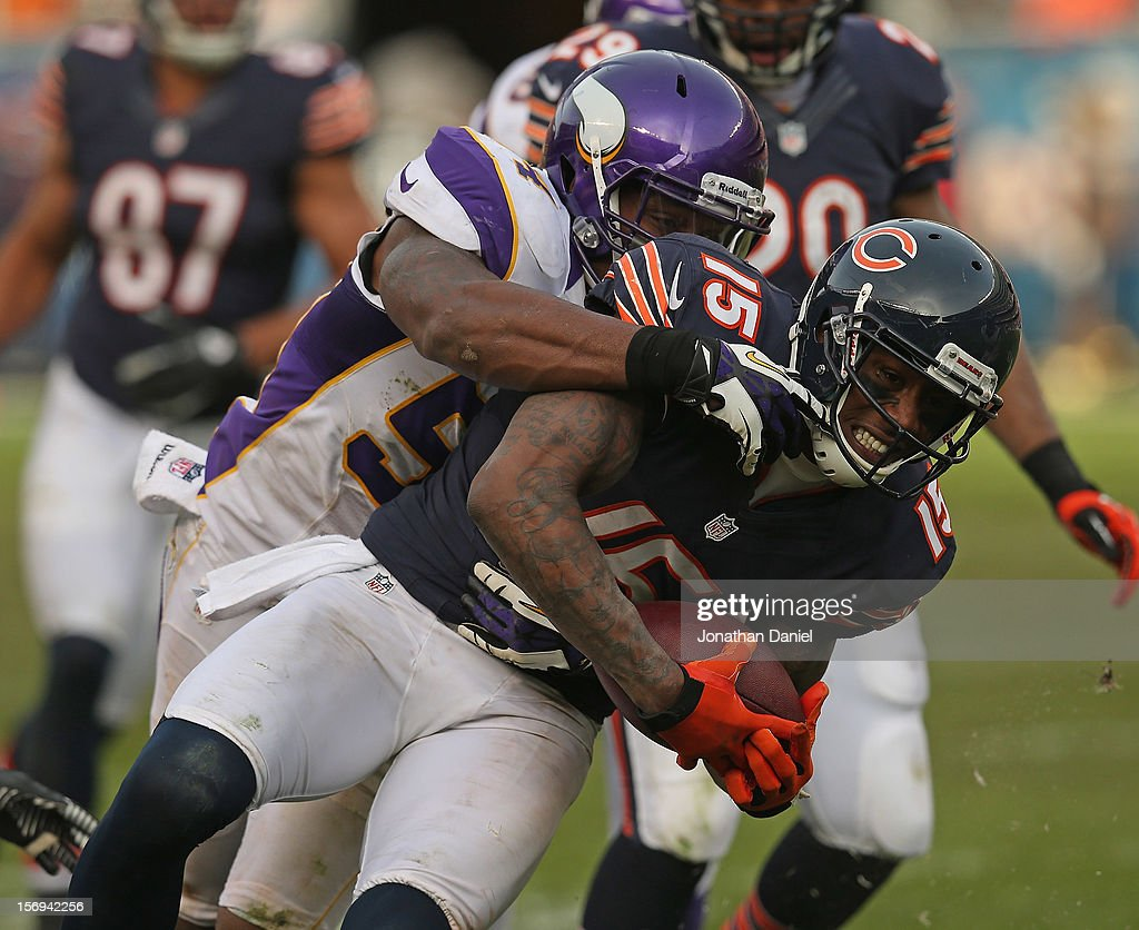 Brandon Marshall #15 of the Chicago Bears is tackled by Jasper Brinkley #54 of the Minnesota Vikings after a catch at Soldier Field on November 25, 2012 in Chicago, Illinois. The Bears defeated the Vikings 28-10.