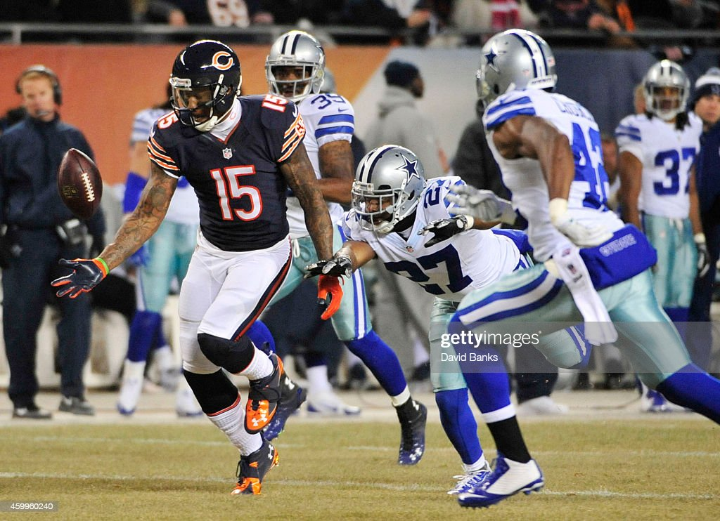 Brandon Marshall of the Chicago Bears makes a onehanded catch as JJ Wilcox of the Dallas Cowboys defends during the second quarter of a game at...